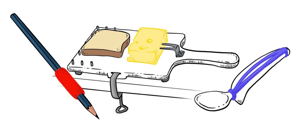 Lyijykynä, johon on laitettu paksunnos, leikkuutelinä jossa pidike pitää juustoa paikallaan. Teline on kiinnitetty myös pöytään. Lusikka, jossa leveä käteen tuleva osa.